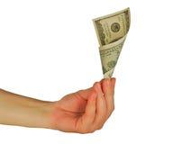 Womanish Hand hält eine Geldanmerkung an Stockbild
