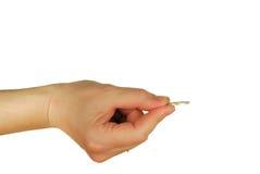 Womanish Hand hält Münzen an Stockfotografie