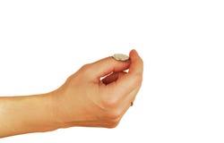 Womanish Hand hält Münzen an Lizenzfreies Stockfoto