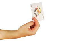 Womanish hand holds a playing cards Royalty Free Stock Photos