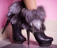 Womanish leg in shoes with fur Royalty Free Stock Photo