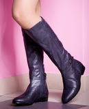 Womanish leg in shoes on the pink Stock Photos