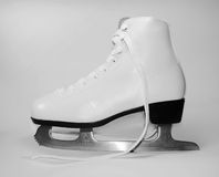 Womanish skate. White womanish skate for a figure-skating Stock Photo