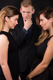 Womanizer and two jealous lovers Royalty Free Stock Photography