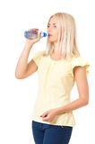 Womanl con la botella de agua Imagen de archivo libre de regalías