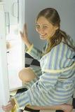 Womanl by the fridge. Stock Photos