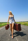 Womanl with her baggage Royalty Free Stock Photo
