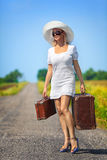 Womanl with her baggage Stock Photos