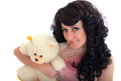 Womanl with makeup in Doll style hugging bear Stock Images