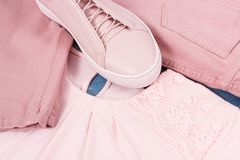 Womanly clothing and accessories, leather shoes, shirt and pants. Womanly clothing and accessories, pink leather shoes, shirt and pants Stock Photo