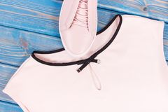 Womanly clothing and accessories on old boards, leather shoes and shirt. Womanly clothing and accessories on old boards, pink leather shoes and shirt Stock Photos