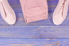 Womanly clothing, copy space for text on old boards. Womanly clothing and accessories, copy space for text or insription on old boards Stock Image
