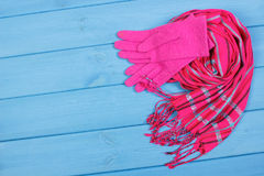 Womanly gloves and shawl on boards, clothing for autumn or winter, copy space for text. Womanly woolen gloves and shawl on boards, warm clothing for autumn or Stock Image