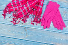 Womanly gloves and shawl on old boards, clothing for autumn or winter, copy space for text. Womanly gloves and shawl on old boards, warm clothing for autumn or Royalty Free Stock Image