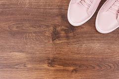 Womanly leather shoes on board. Womanly leather shoes on rustic board, copy space for text or inscription Royalty Free Stock Images