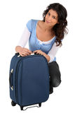 Womanopening suitcase Stock Images