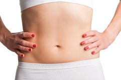 Womans Abs. Closeup of a fit womans abs isolated on a white background Royalty Free Stock Photo