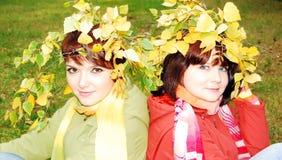 Womans in the autumn park. Stock Photos