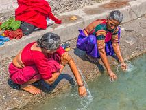 Womans bathing in the Ganges at Rishikesh Stock Image
