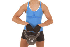 Womans body blue tank fitness hold weight Stock Photo