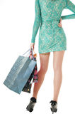 Womans body  in a short  dress carrying shopping gift bags. Stock Photo