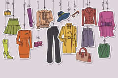 Womans clothing and accessories hanging on ropes Stock Photography