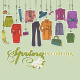 Womans clothing and accessories hanging on ropes Royalty Free Stock Image