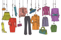 Womans colored clothing and accessories hanging on Stock Photos