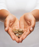Womans cupped hands showing euro coins Royalty Free Stock Photography