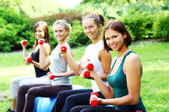 Womans doing fitness exercises Royalty Free Stock Photos