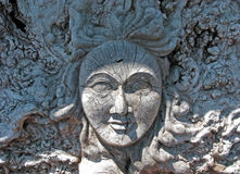 A Womans Face Carved in a Distressed Wood Root Ball. Royalty Free Stock Images