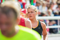 Womans face at the final stretch at Stockholm Stadion in ASICS S Royalty Free Stock Image