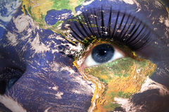 Womans face with planet Earth texture and alaska state flag inside the eye. Elements of this image furnished by NASA Stock Photo