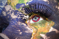 Womans face with planet Earth texture and arkansas state flag inside the eye. Elements of this image furnished by NASA Royalty Free Stock Images