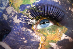 Womans face with planet Earth texture and botswana flag inside the eye. Elements of this image furnished by NASA Stock Photo