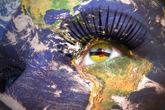 Womans face with planet Earth texture and brunei flag inside the eye. Elements of this image furnished by NASA Stock Image