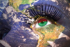 Womans face with planet Earth texture and burkina faso flag inside the eye. Elements of this image furnished by NASA Royalty Free Stock Photos