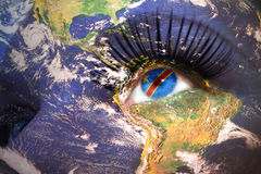 Womans face with planet Earth texture and democratic republic of the congo flag inside the eye. Royalty Free Stock Images