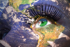 Womans face with planet Earth texture and djibouti flag inside the eye. Royalty Free Stock Photography