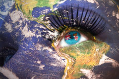 Womans face with planet Earth texture and fiji flag inside the eye. Elements of this image furnished by NASA Stock Photography