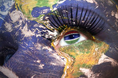 Womans face with planet Earth texture and gambia flag inside the eye. Elements of this image furnished by NASA Stock Photos