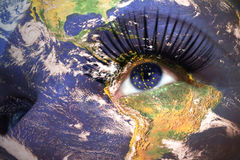 Womans face with planet Earth texture and indiana state flag inside the eye. Royalty Free Stock Photos