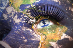 Womans face with planet Earth texture and israeli flag inside the eye. Elements of this image furnished by NASA Royalty Free Stock Images