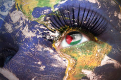 Womans face with planet Earth texture and jordan flag inside the eye. Elements of this image furnished by NASA Stock Photo