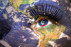 Womans face with planet Earth texture and laos flag inside the eye. Elements of this image furnished by NASA Royalty Free Stock Images