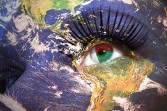 Womans face with planet Earth texture and madagascar flag inside the eye. Stock Image
