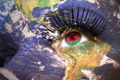 Womans face with planet Earth texture and malawi flag inside the eye. Royalty Free Stock Photo