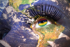 Womans face with planet Earth texture and mauritius flag inside the eye. Elements of this image furnished by NASA Stock Image