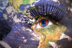 Womans face with planet Earth texture and mongolian flag inside the eye. Elements of this image furnished by NASA Stock Photos