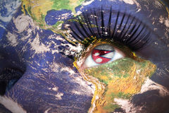 Womans face with planet Earth texture and nepal flag inside the eye. Elements of this image furnished by NASA Royalty Free Stock Images
